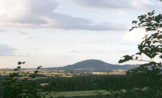The Wrekin from the north. The little hill at the right edge of the Wreakin is Ercall Hill. The little hill on the left is called Little Hill.