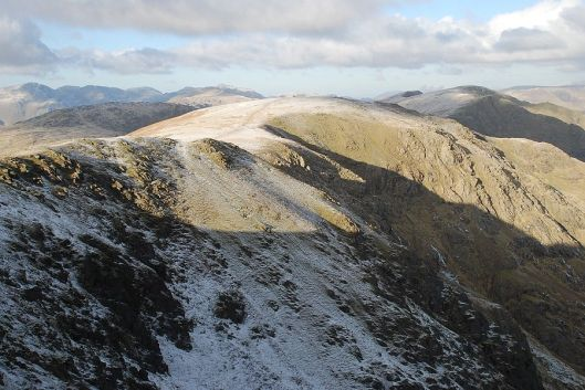 Two Lancashire giants; the summits of Coniston Old Man and Swirl How. Photo Credit Wainwright Routes.