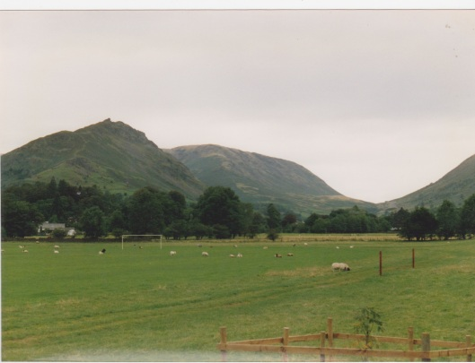 The Lion and the Lamb look down on the Grasmere Sports' field. (Where sheep may safely graze)