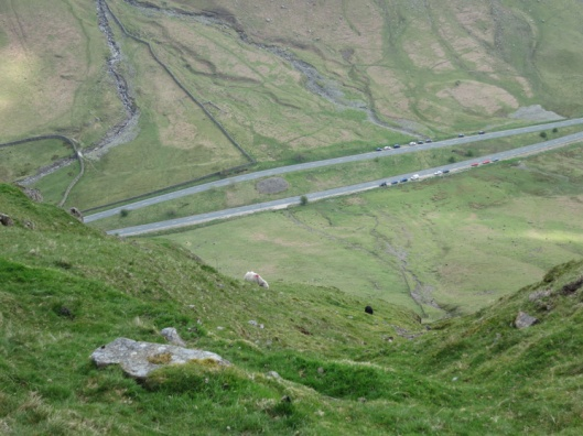 The cairn lies between the dual carriageway on Dunmail Raise. Photo Credit  Lakeland Fells